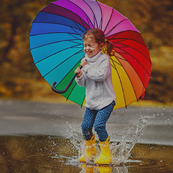 Little girl with colourful umbrella